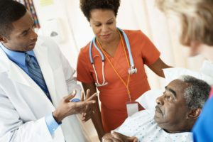 Doctor Talking with Stroke Patient in Hospital